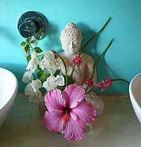 Flower-decorated buddha in the bathroom at Anamaya Resort