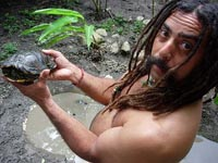 Simon holding a jungle turtle at Rainsong Wildlife Sanctuary